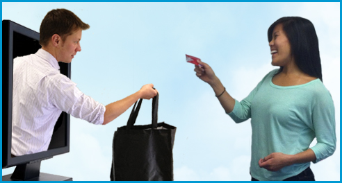A picture of a man handing a woman a shopping bag.